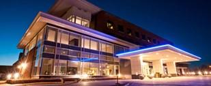 Modern 118 Bed Hospital/Suburban Lake Community/Outdoorsmans Paradise! Logo